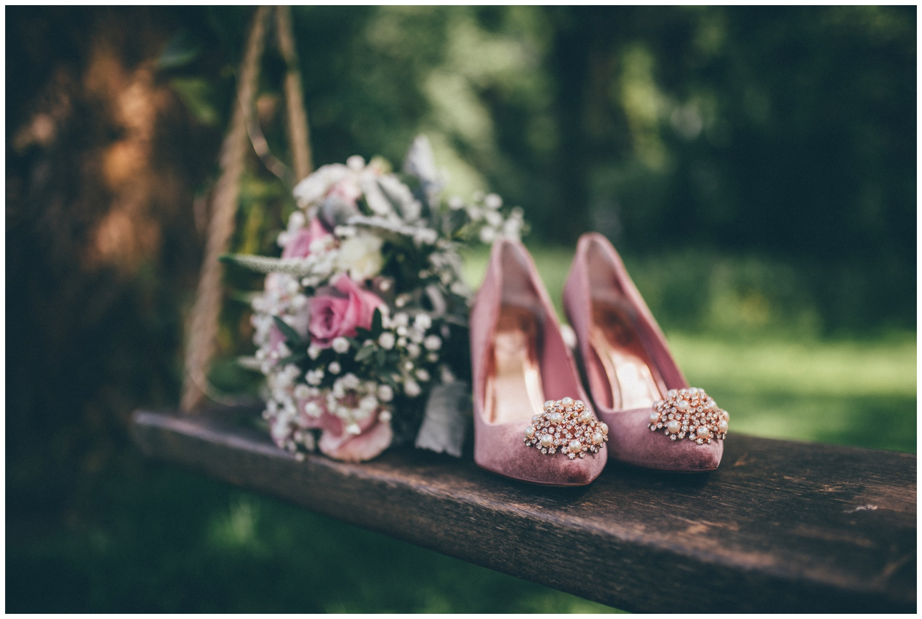 Stunning suede pink Ted Baker wedding shoes at Trafford Hall in Cheshire.