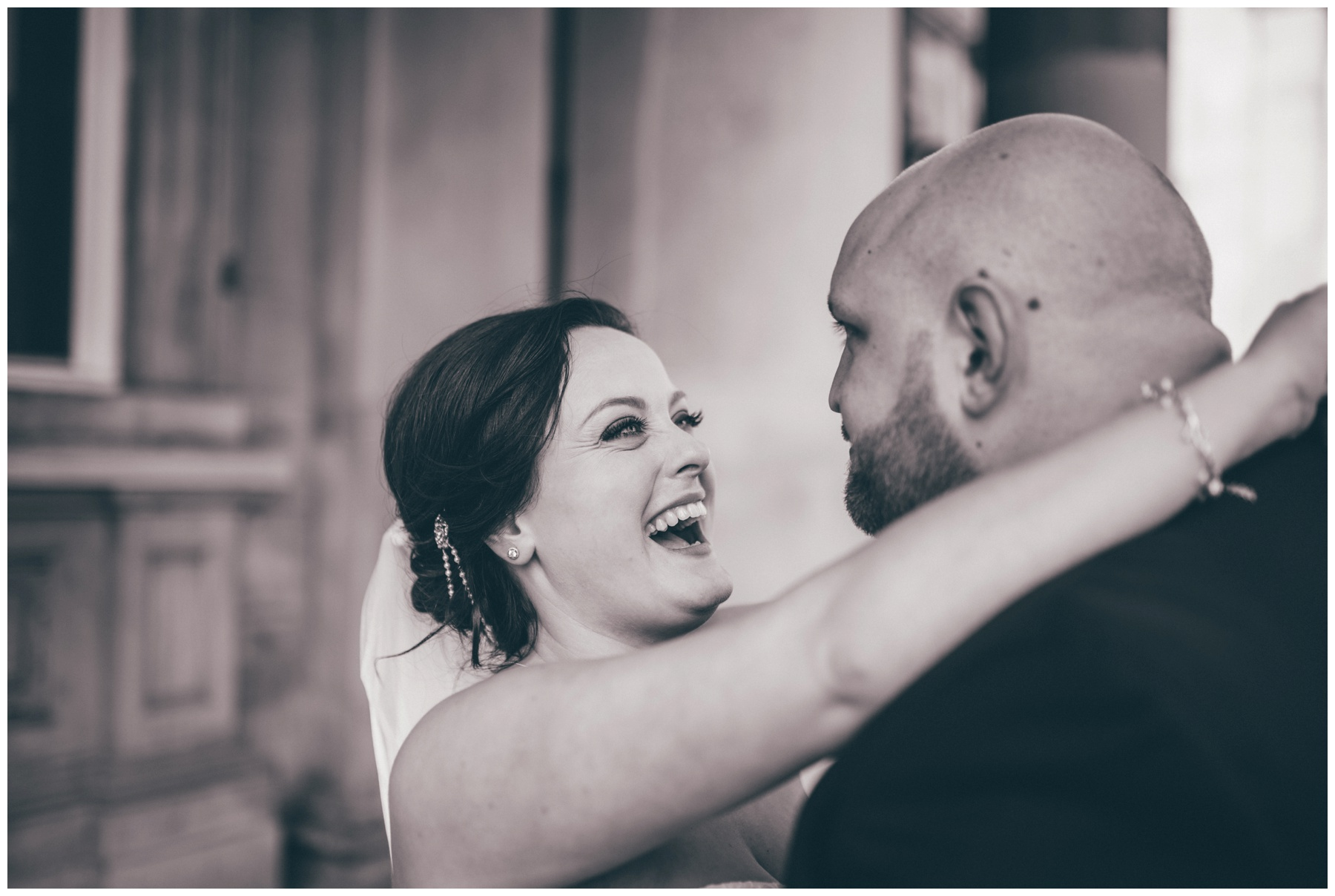 The new husband and wife share a joke after their St George's Hall wedding in Liverpool.