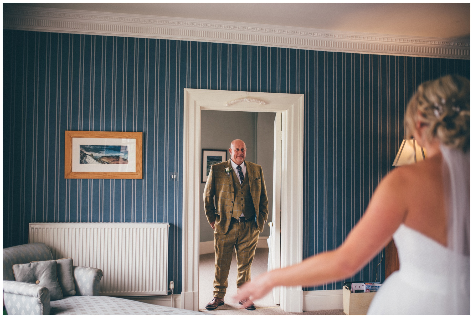 Father of the Bride sees his daughter in her wedding gown at the Swinton Estate in Yorkshire.