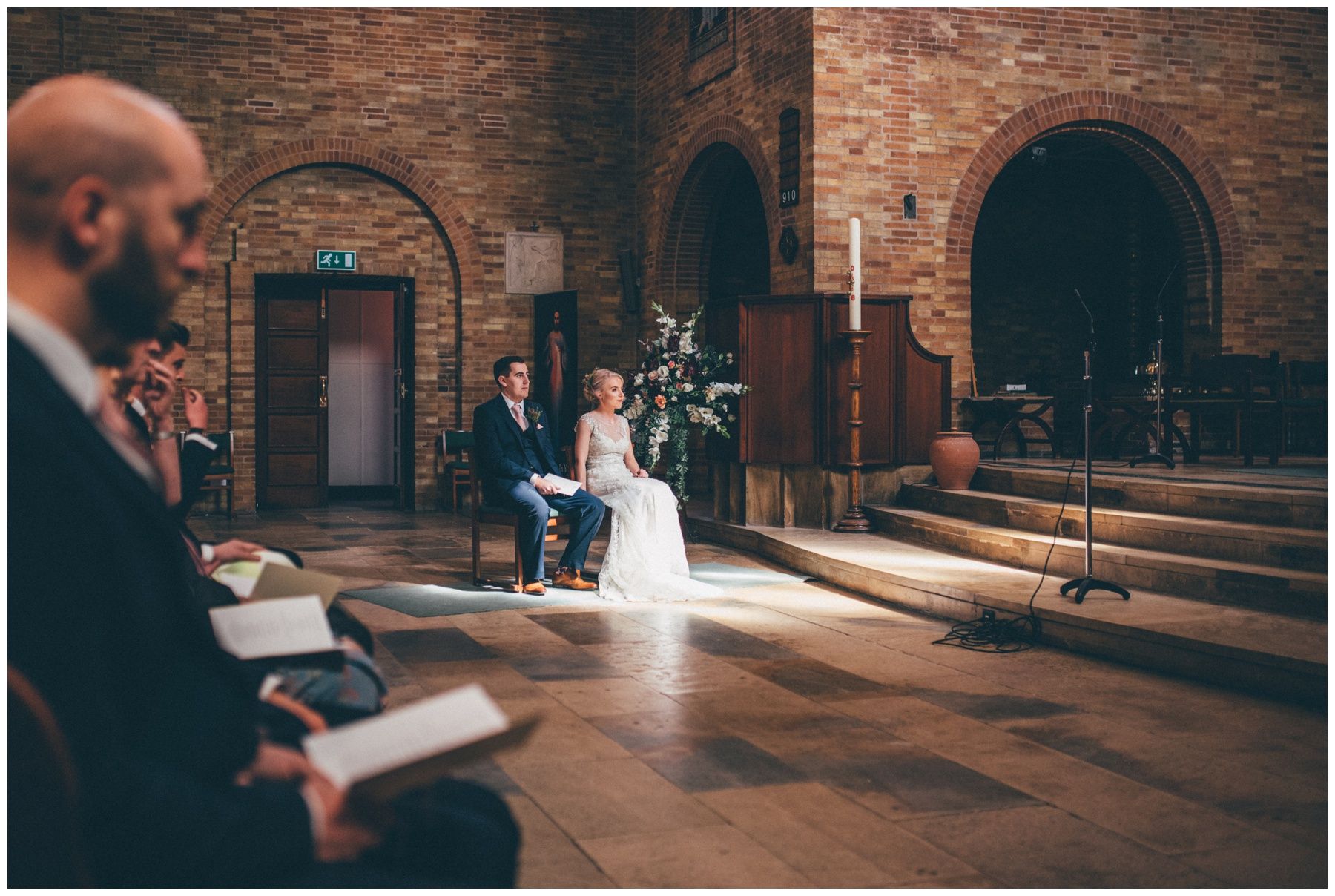 Bride and groom sat at their Sheffield city centre church wedding.