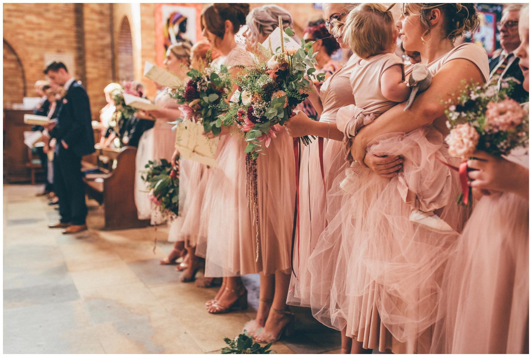 Stunning bridesmaids wild flower arrangements.