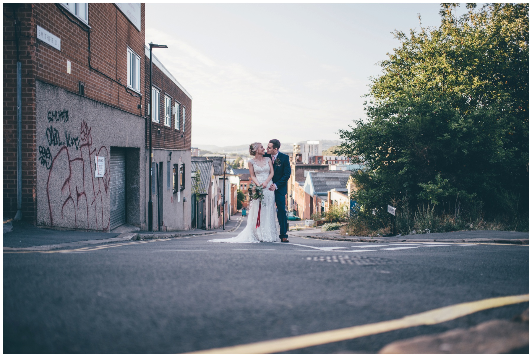 Bride and groom explore the city centre of Sheffield surround The Hide, their cool wedding venue.