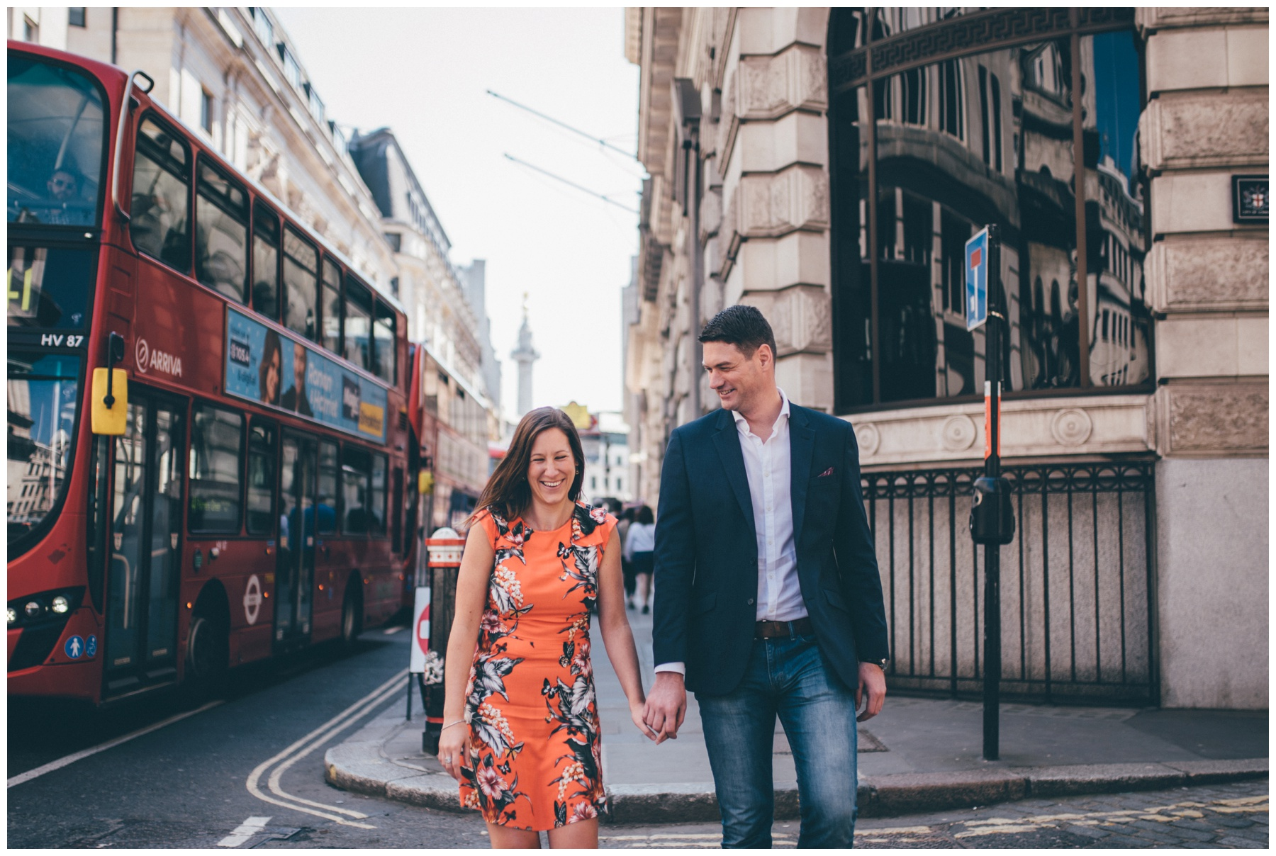 Cute couple stroll through London city centre together for their engagement shoot.