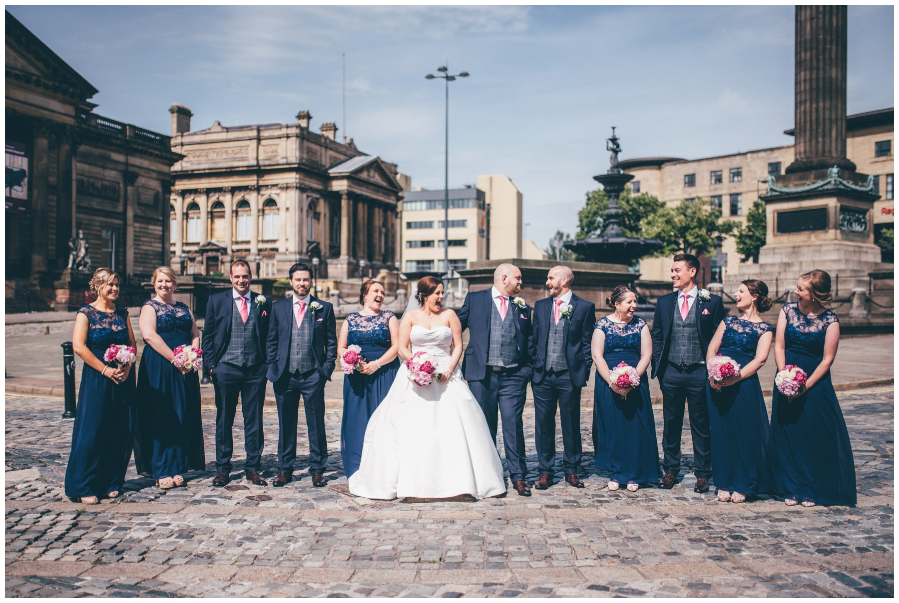 Bride, groom and Their bridal party all together outside St Georges Hall in Liverpool.
