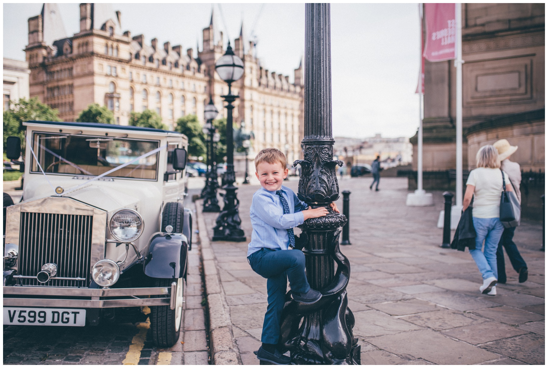 Cute little boy outside St Georges Hall wedding.