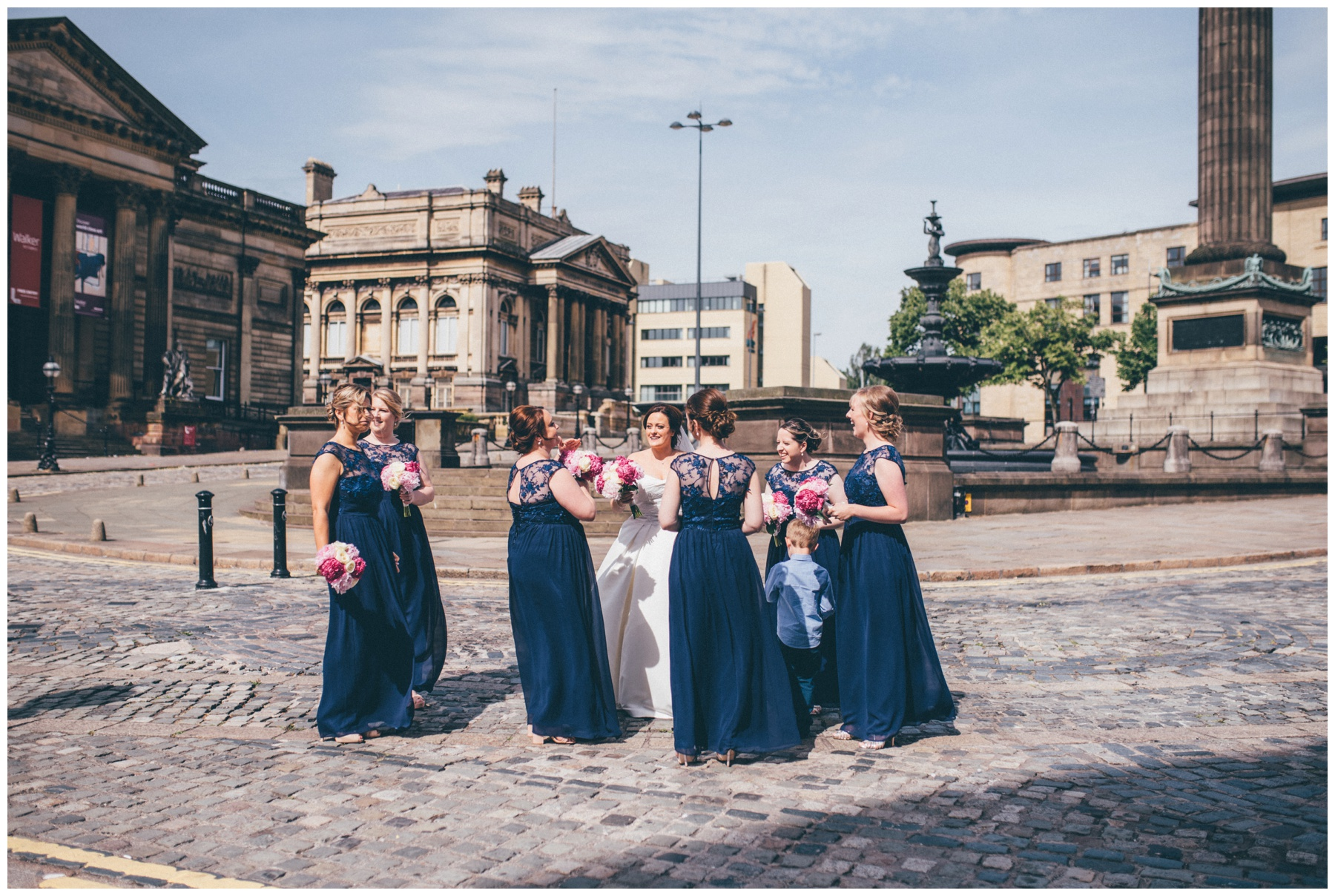 Bride and her bridesmaids all together outside St Georges Hall in Liverpool.