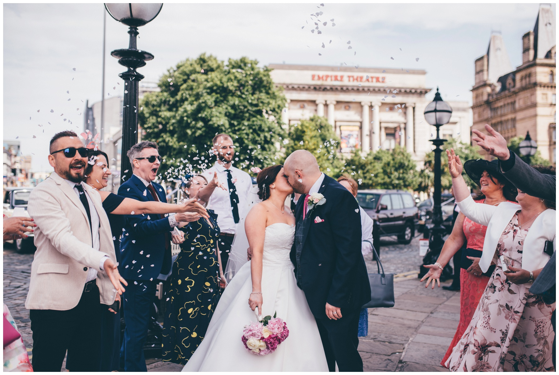 Confetti gets thrown at the bride and groom outside St Georges Hall in Liverpool.