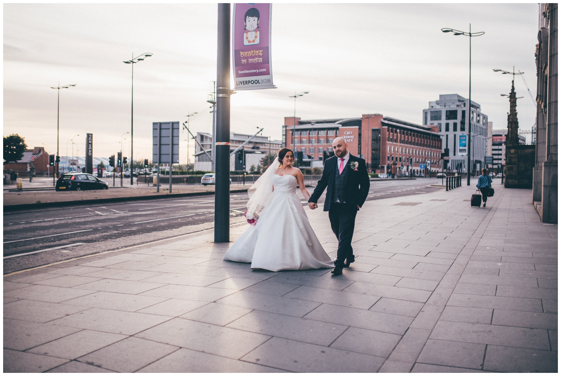 New bride and groom on the roof terrace at Liverpool Wedding venue, Oh Me Oh My, overlooking the Liver Building.