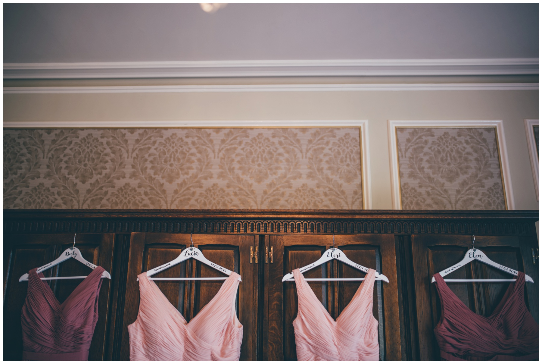 Bridesmaids dresses hung up in the bridal suite at Tilstone House in Cheshire.