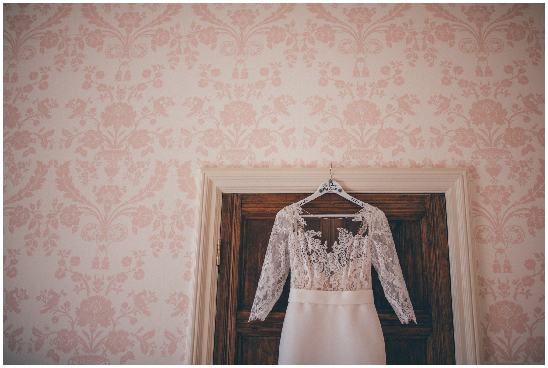 Wedding dress hung up in the bridal suite at Tilstone House in Cheshire.