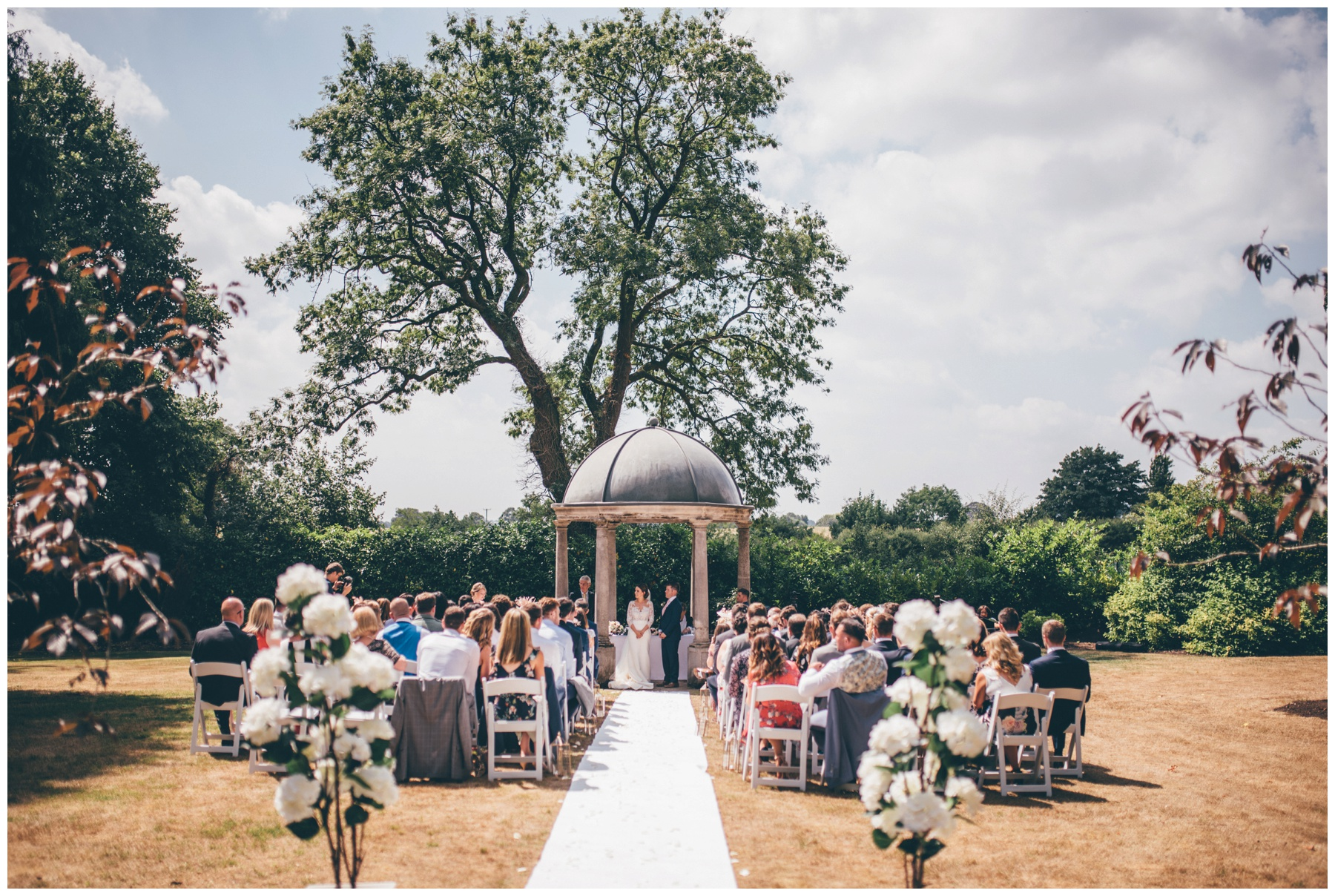 Bride and Groom become husband and wife in an outdoor wedding ceremony at Tilstone House in Tarporley, Cheshire.