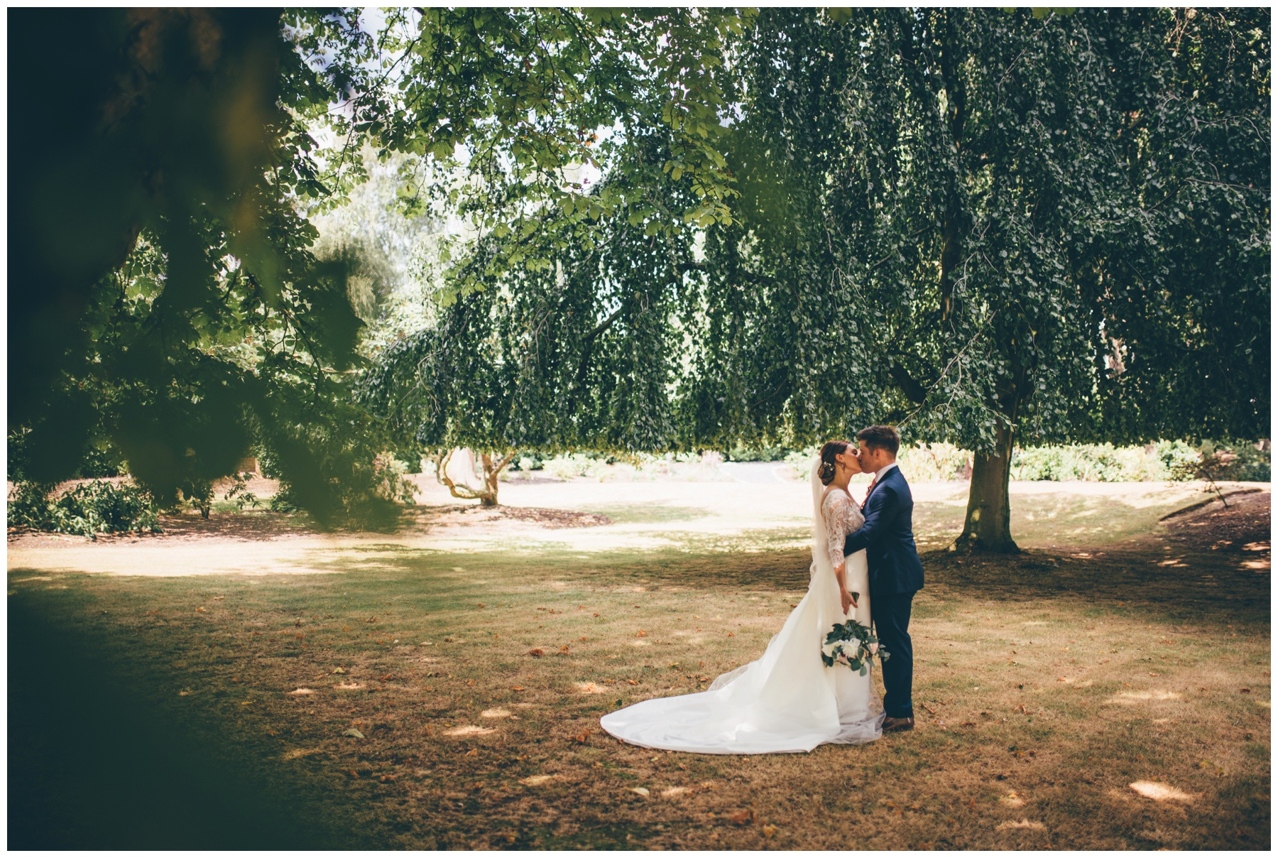 Beautiful bride and groom in the grounds at Tilstone House in Cheshire.