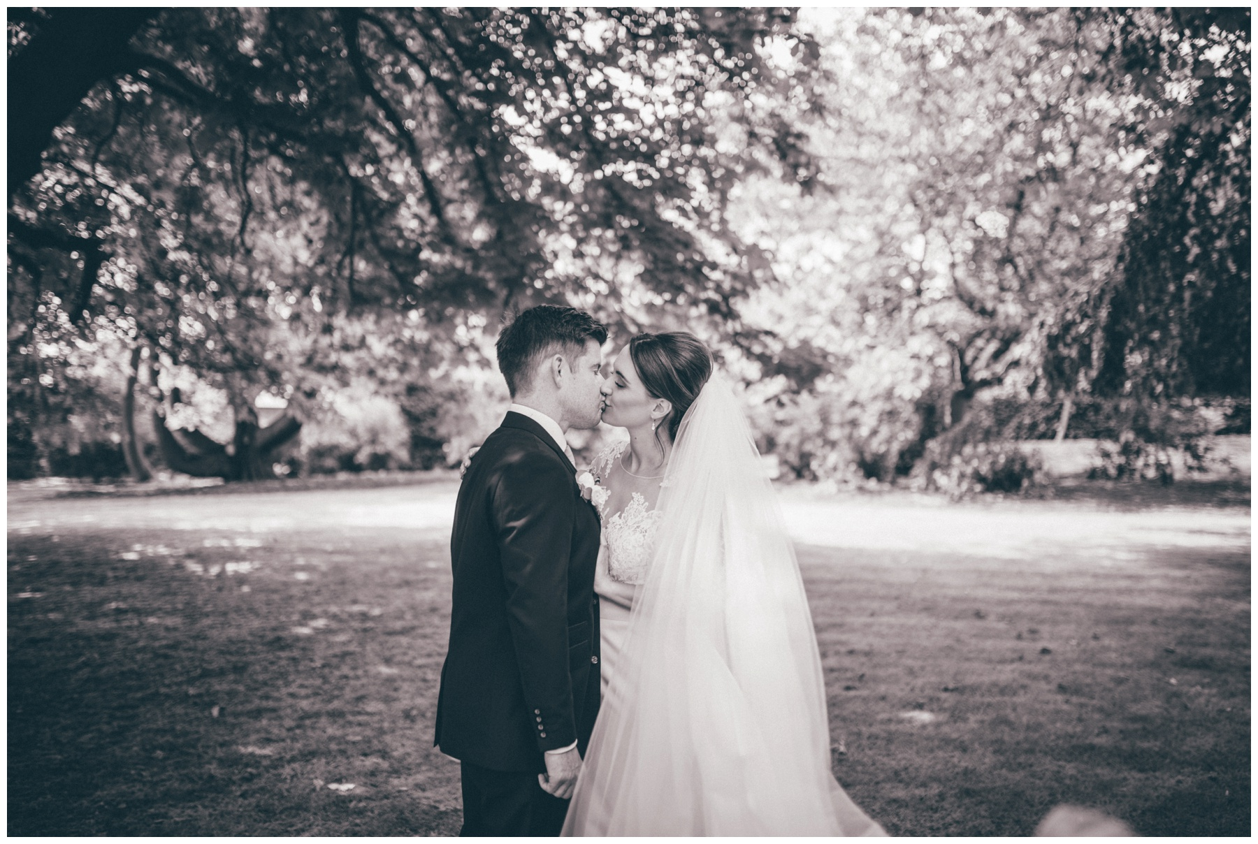 Bride and Groom in the beautiful gardens at Tilstone House in Cheshire.