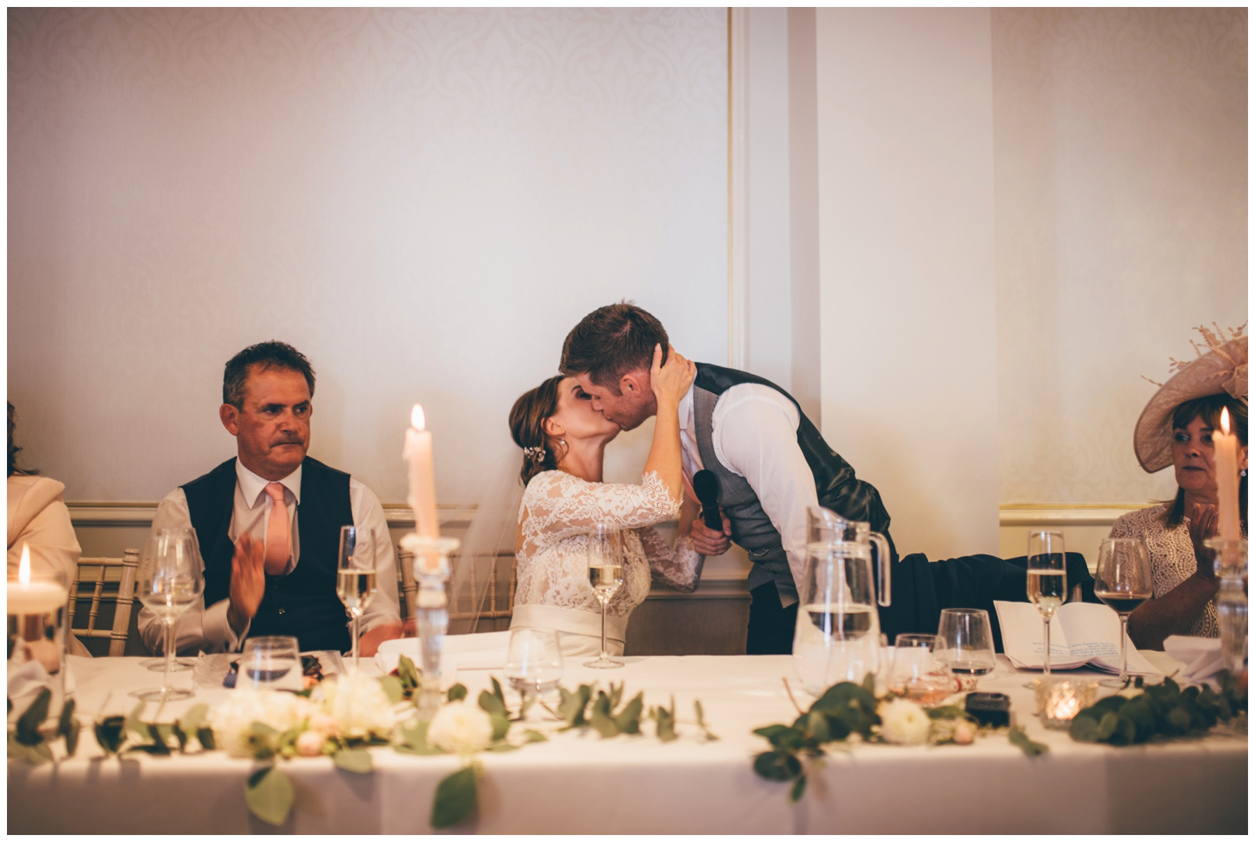 Bride and groom kiss after the speeches at Tilstone House.