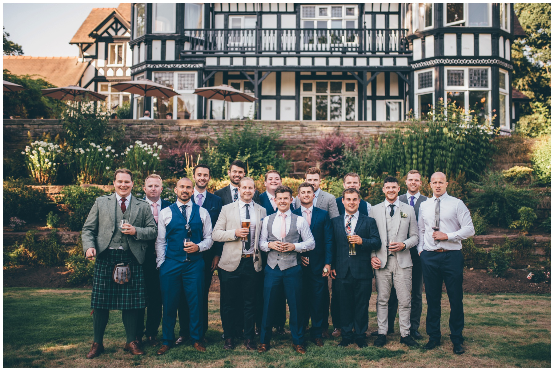 Groom and all his friends outside the wedding venue, Tilstone House.