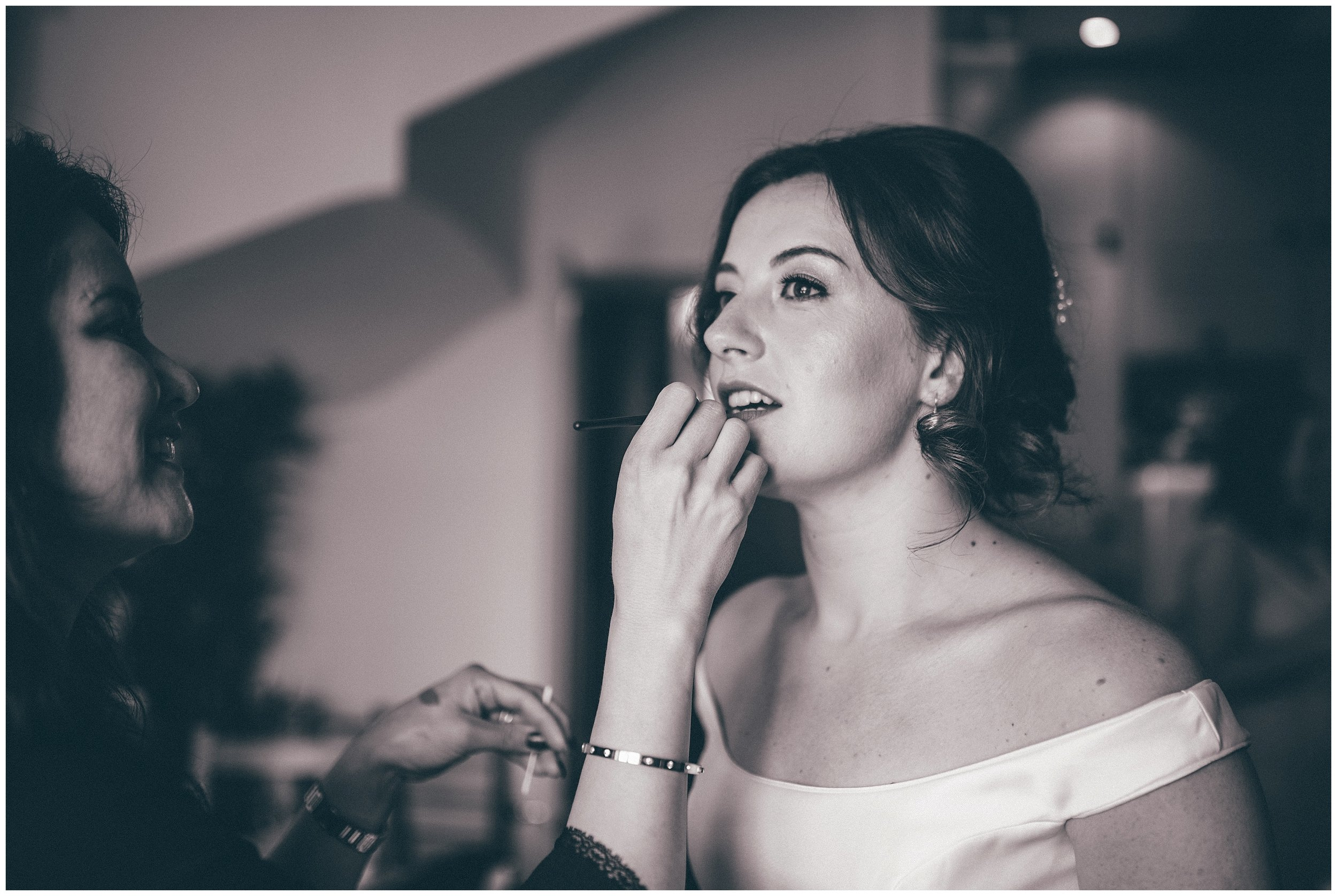 Bride gets finishing touches doe to her makeup by local MUA, Adie Brooks.