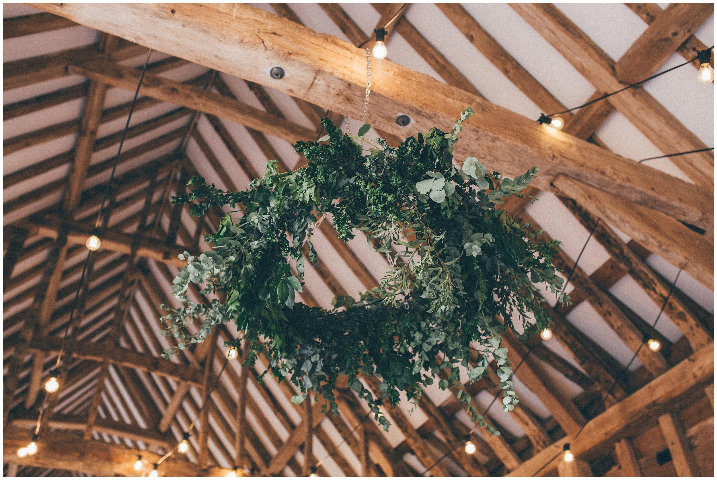 Floral wreath at Henham Park wedding barns.