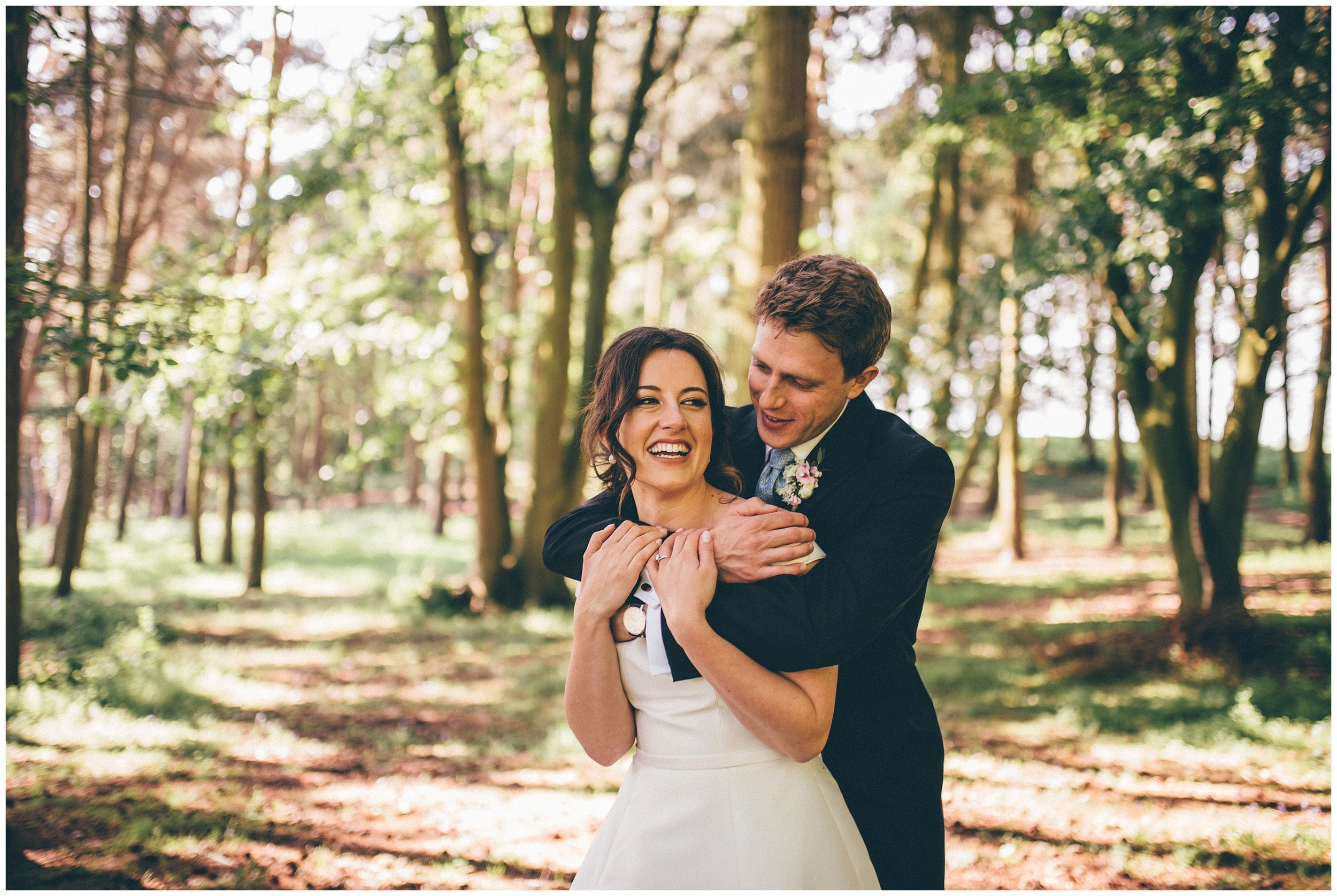 Bride and groom photographed at Henham Park wedding barns by Cheshire wedding photographer.