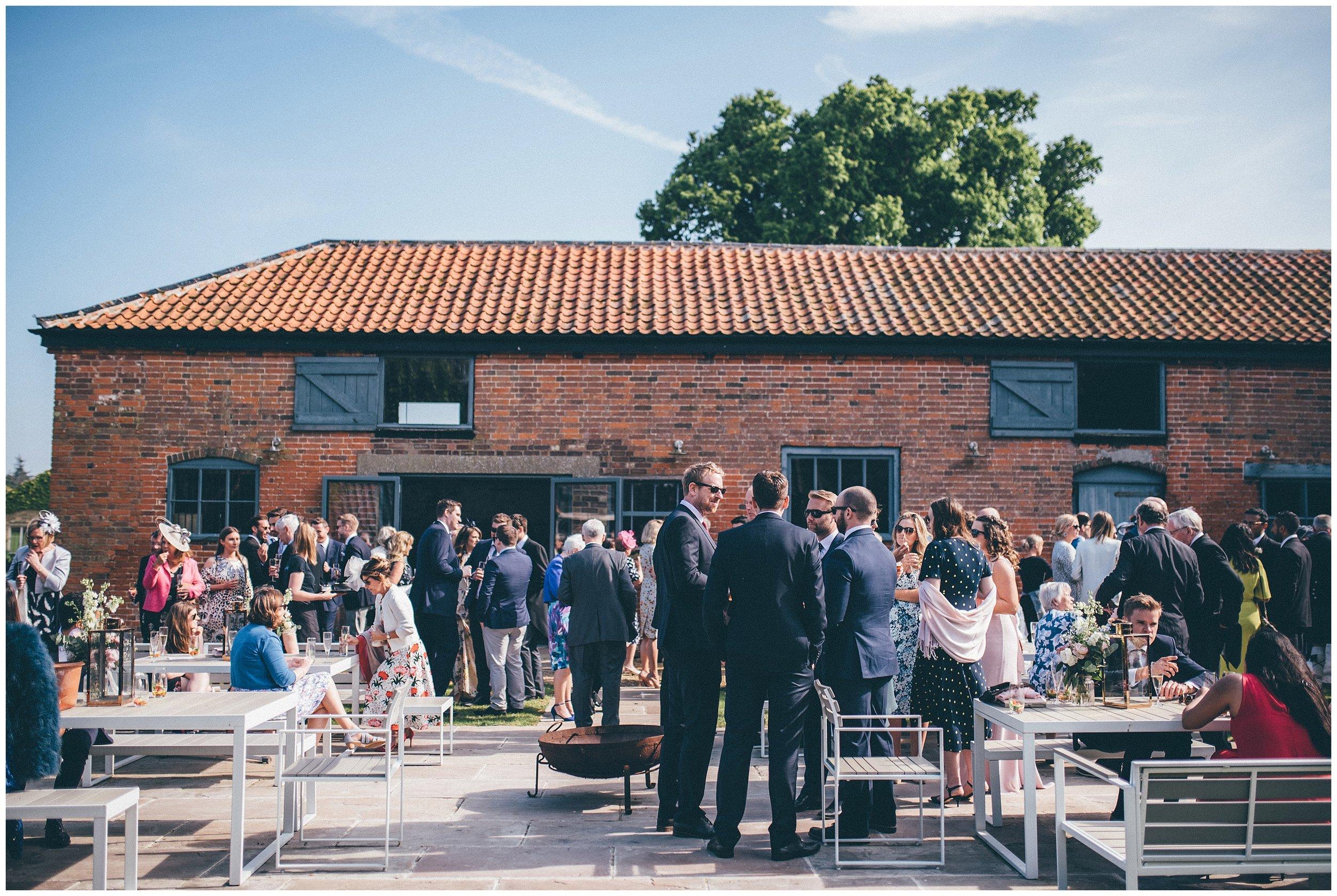 Wedding guests enjoying the reception at Henham wedding barns.