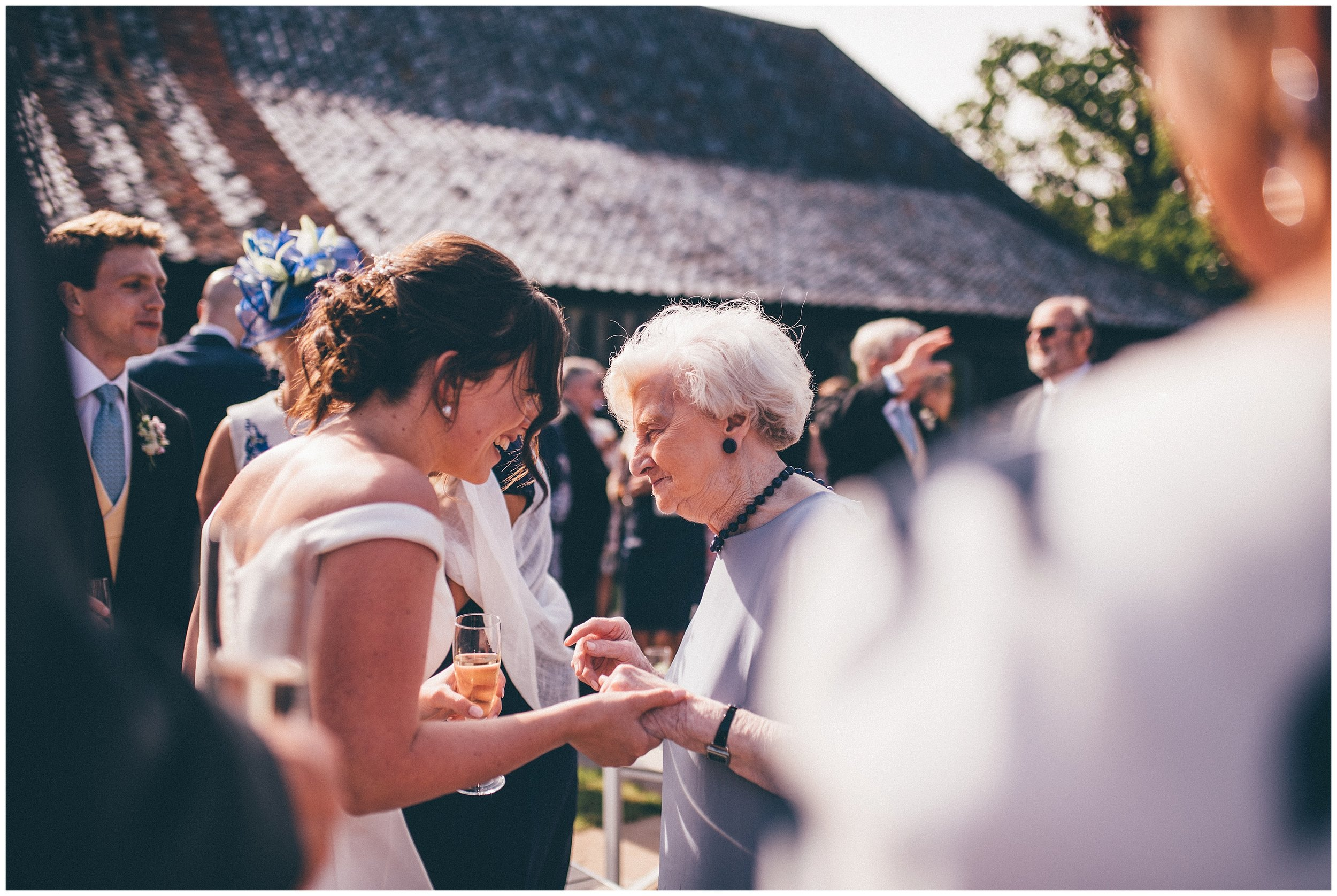 Wedding guests enjoying the reception at Henham Park wedding barns.