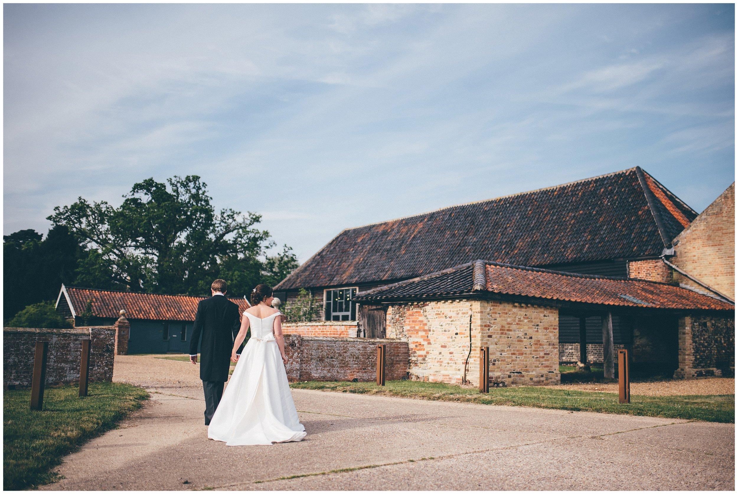 Bride and groom have their wedding photographs taken at Henham Park wedding barns.