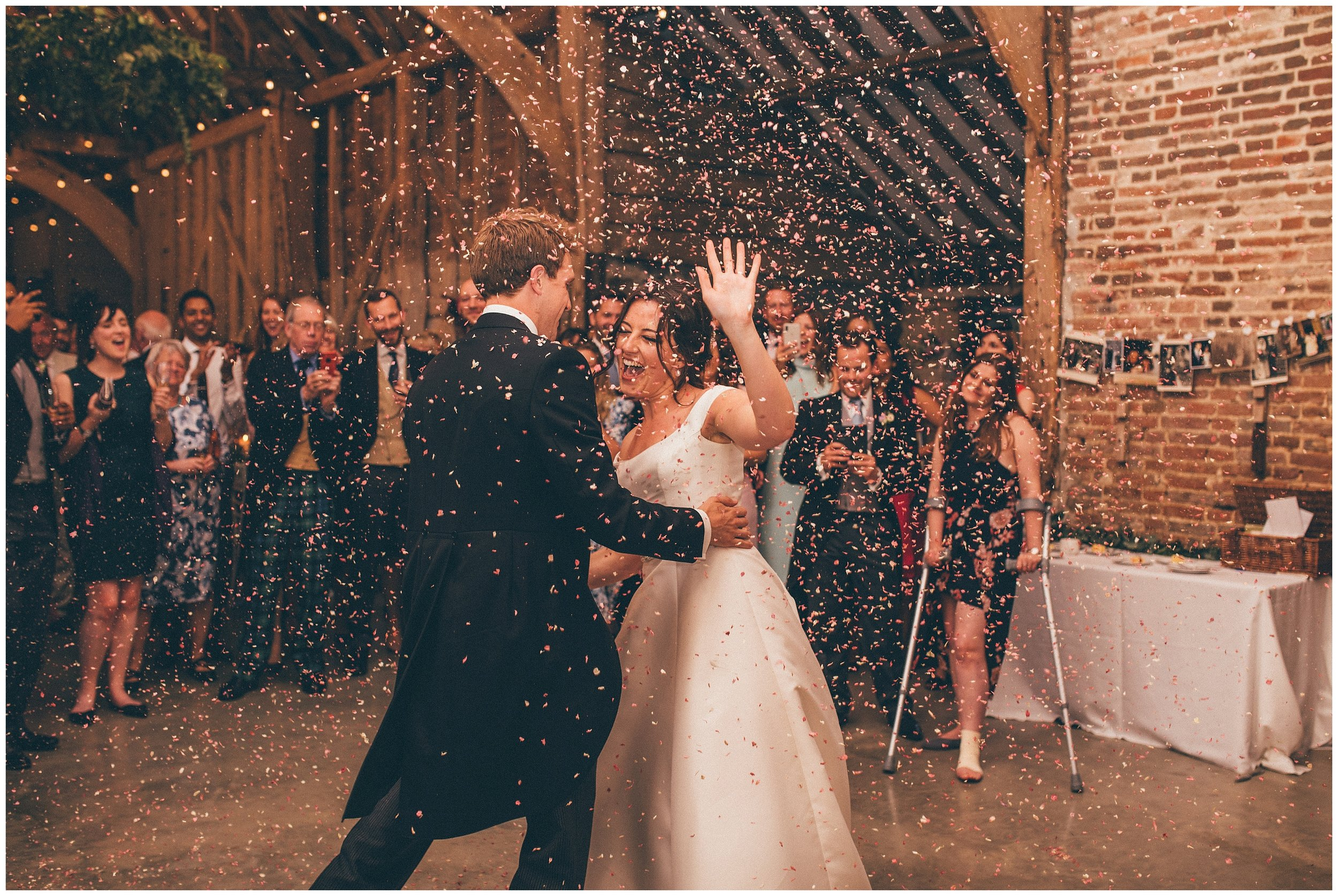 Confetti canon during the First Dance at Henham Park wedding barns in Southwold.