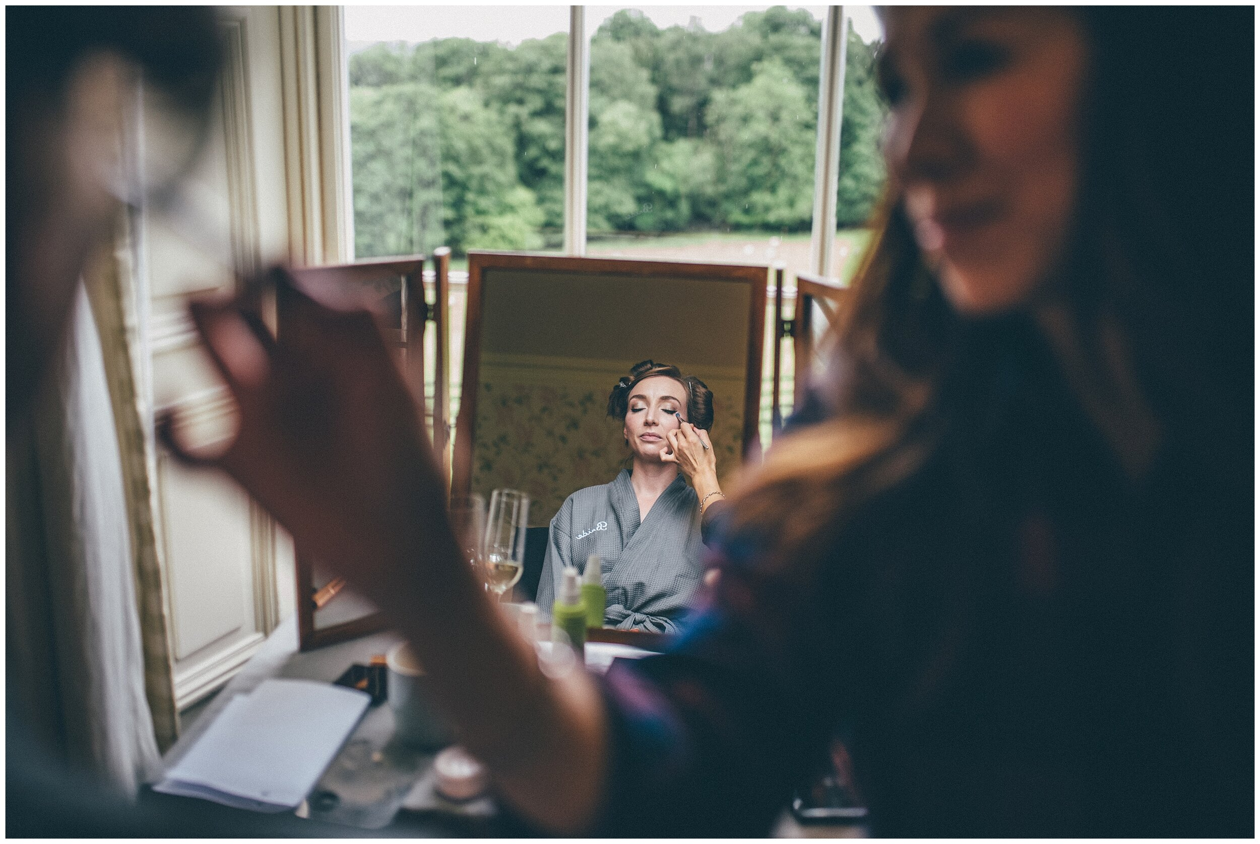 Bride gets her make done on the wedding morning at Silverholme wedding venue.