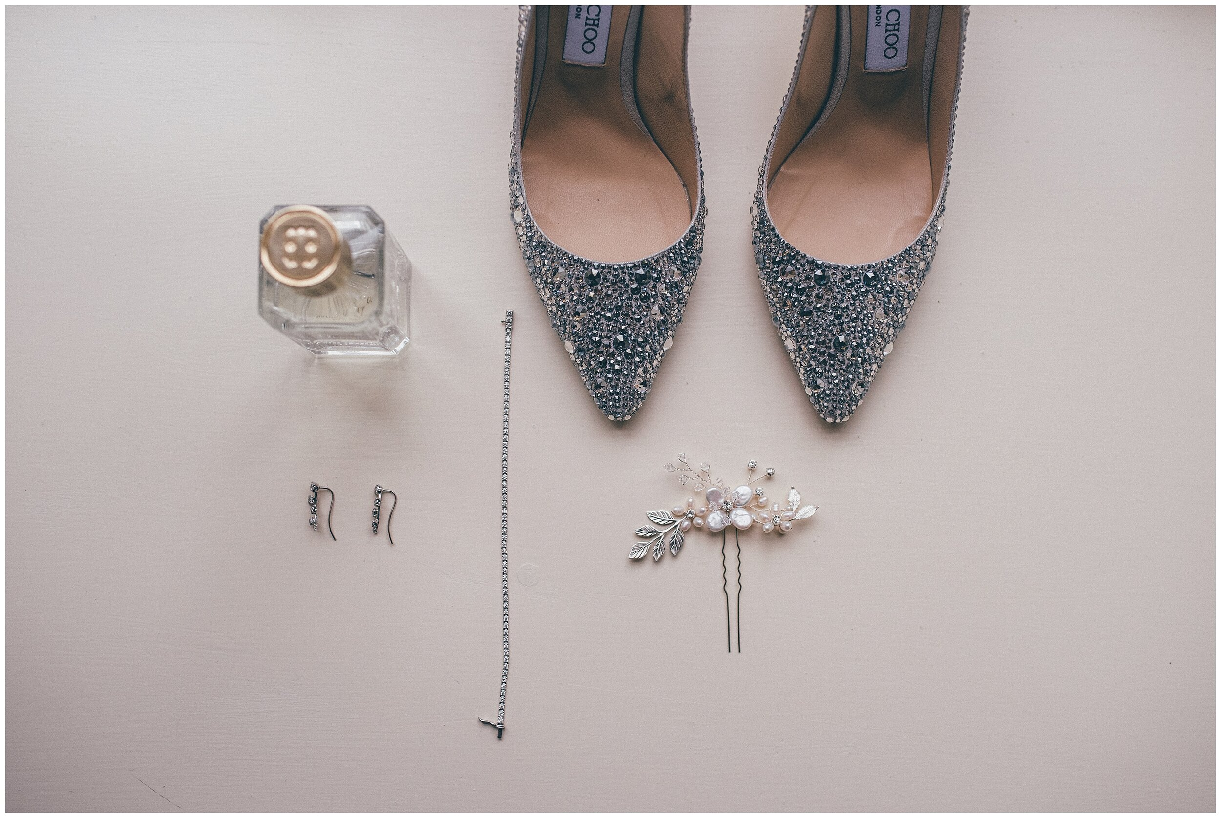 Beautiful Jimmy Choo wedding shoes and other wedding details at Lake District wedding.