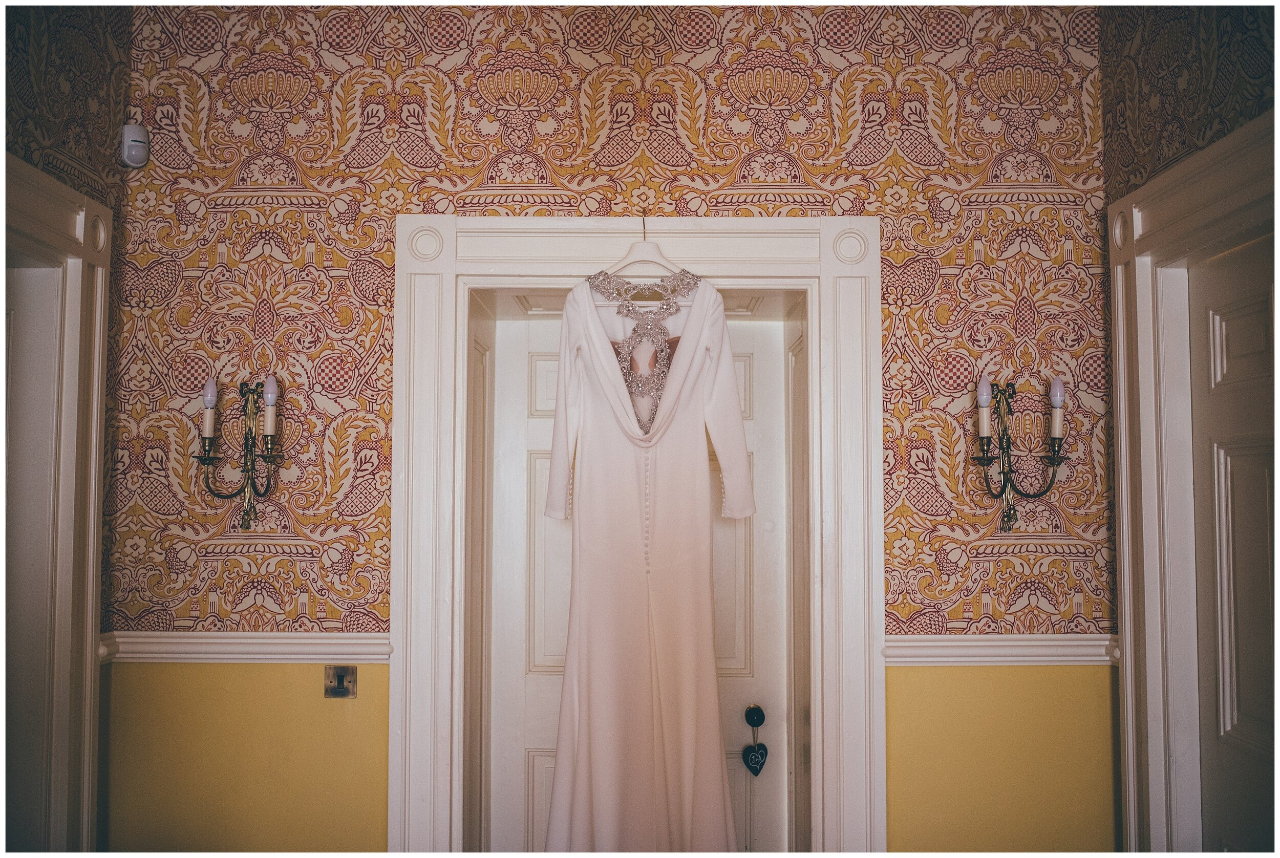Pronovias wedding gown hung up outside the Bridal Suite at Silverholme Estate in the Lake District.