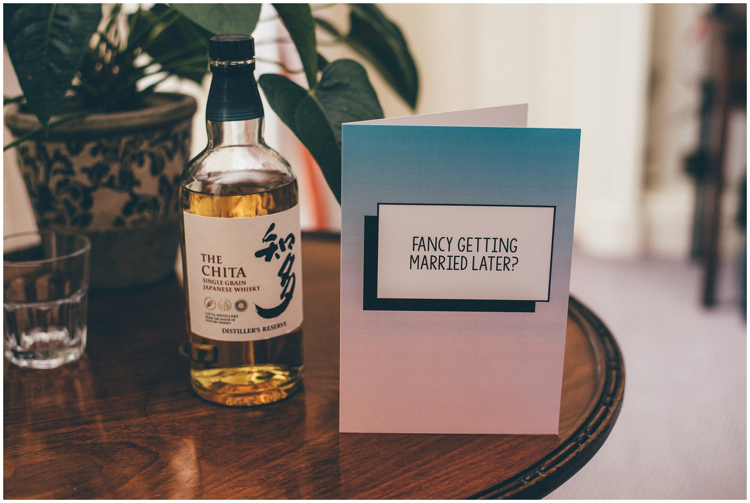 Grooms wedding card and whisky that he shared with his Best Man.