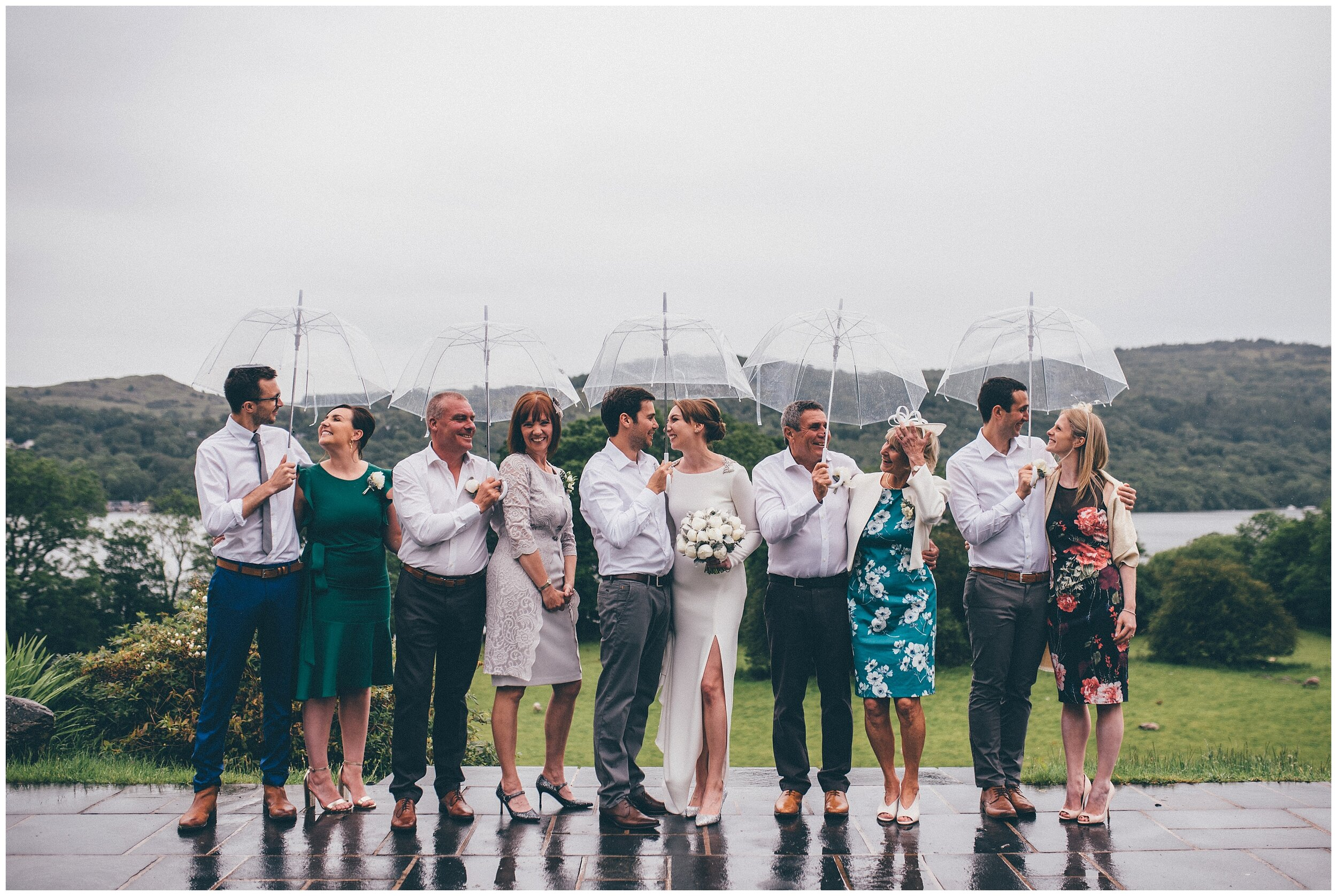 Fun family photograph in the rain at Lake Distrct wedding venue.