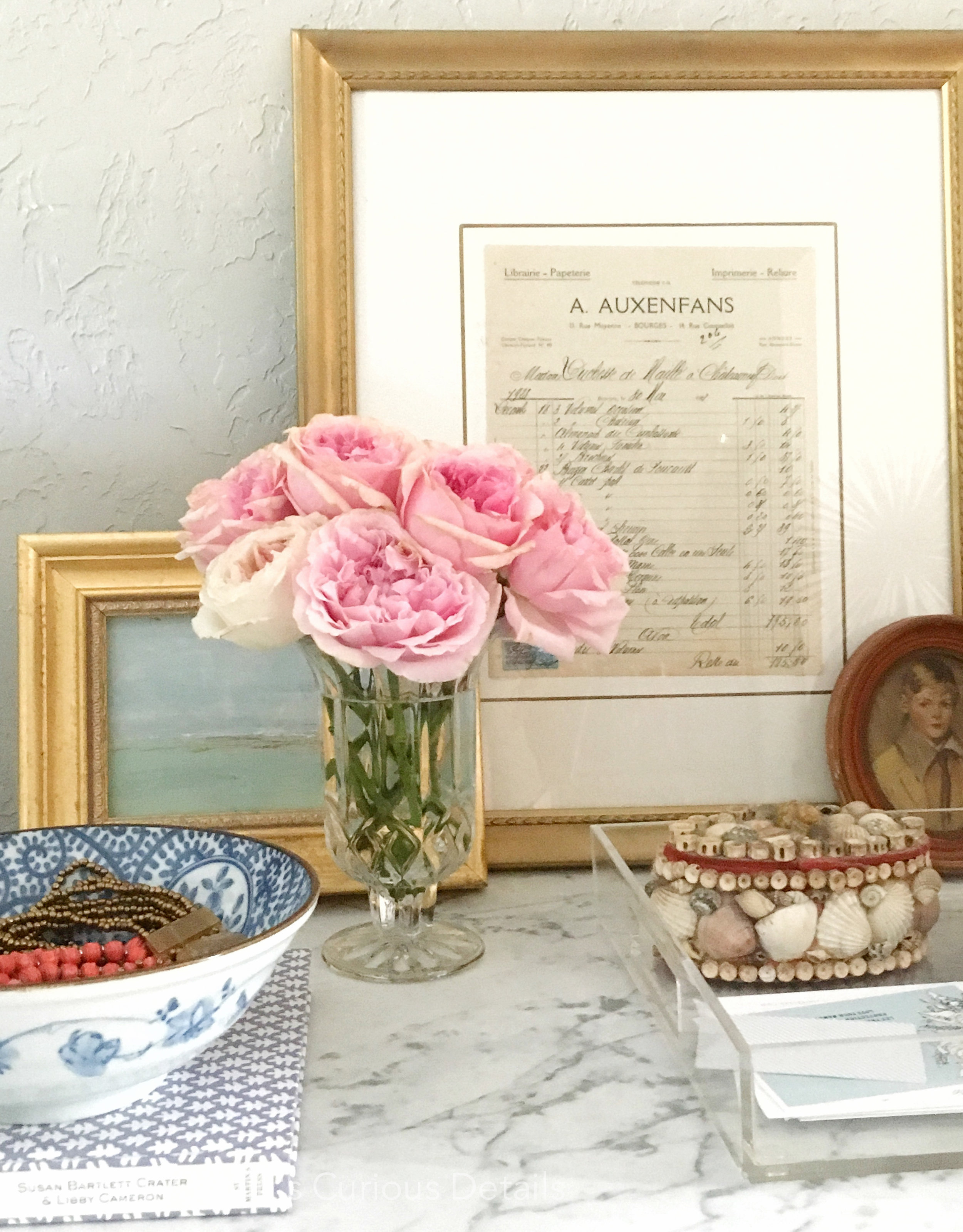 Detail of Holly's bedside table with beautiful cottage roses from  Moosefeathers Florist  in Brenham, Tx. Coastal painting by me :)