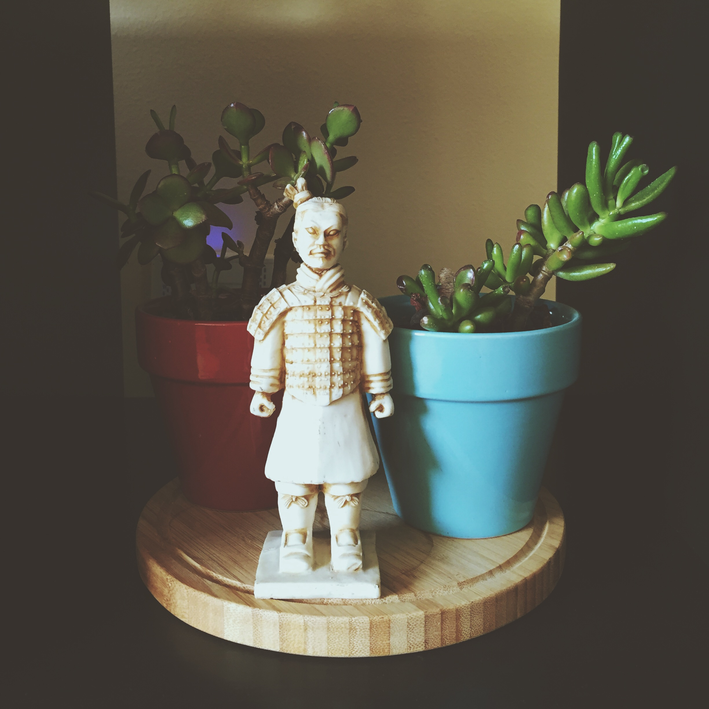 """Detail of another """"heritage"""" possession that made the cut — a souvenir  terra cotta  soldier, brought back from China by Tor's dad in 1967."""