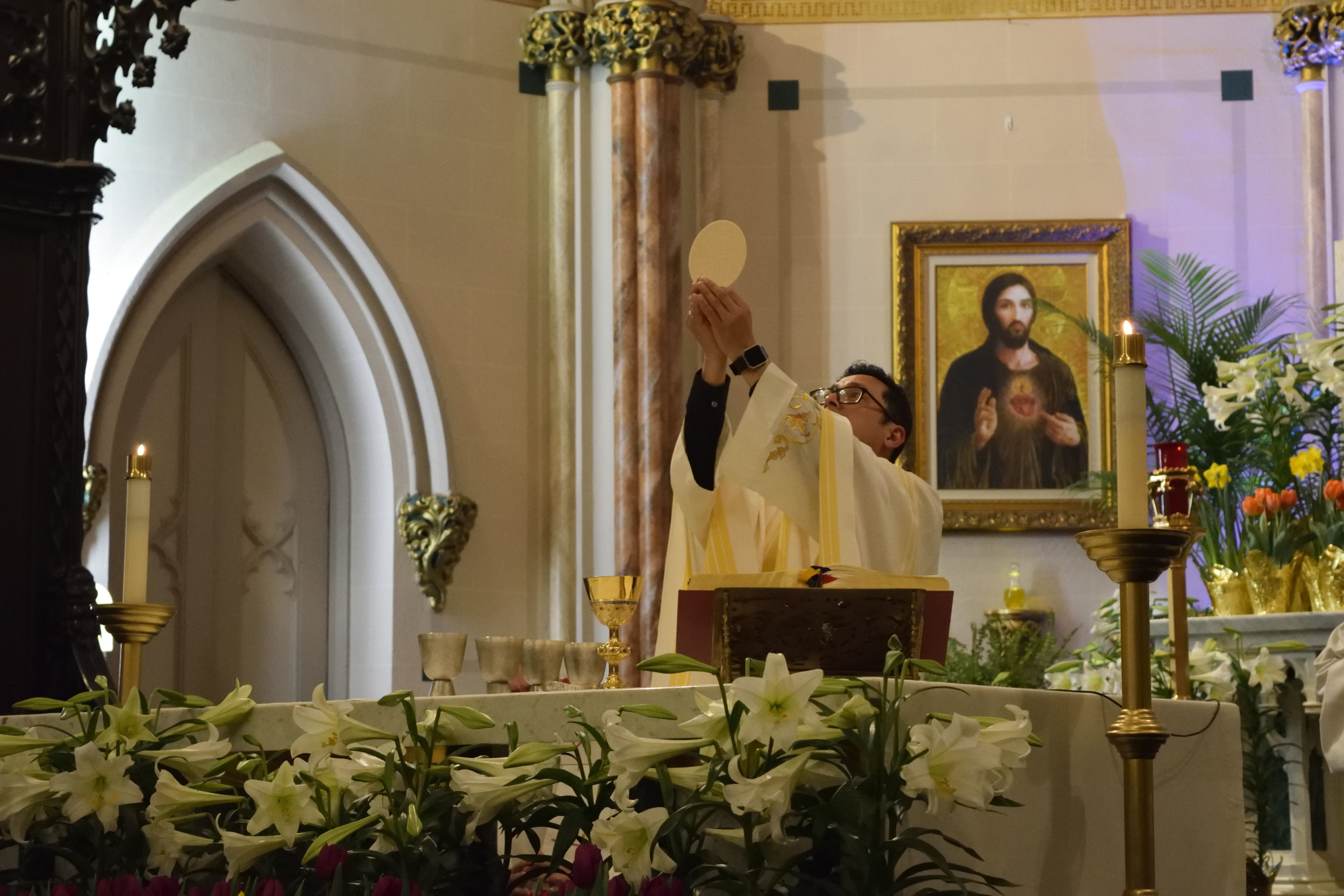 """MASS TIMES   The Eucharist is """"the  source and summit of the Christian life."""" ( CCC , 1324)   Learn More"""