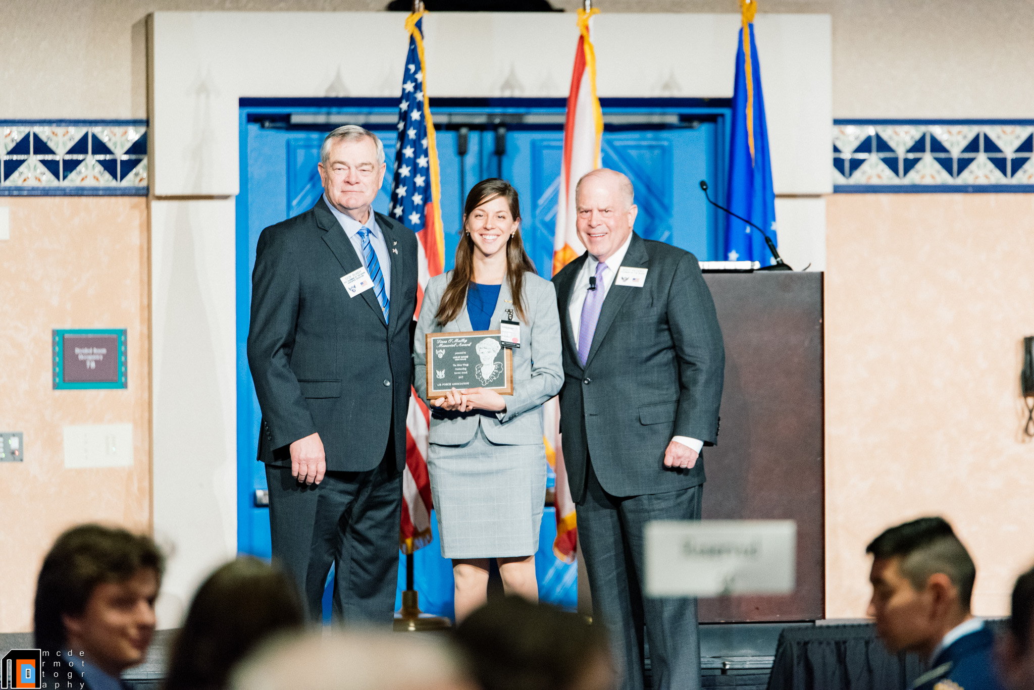 Brig Gen (Ret.) Dick Bundy, AFA Chairman of the Board for Aerospace Education and Secretary Whit Peters, AFA Chairman of the Board, present Ms. Ashley Kinsey with the AFA Diane O'Malley Silver Wings Outstanding Service Award.  Photo by Cadet Isaac McDermott