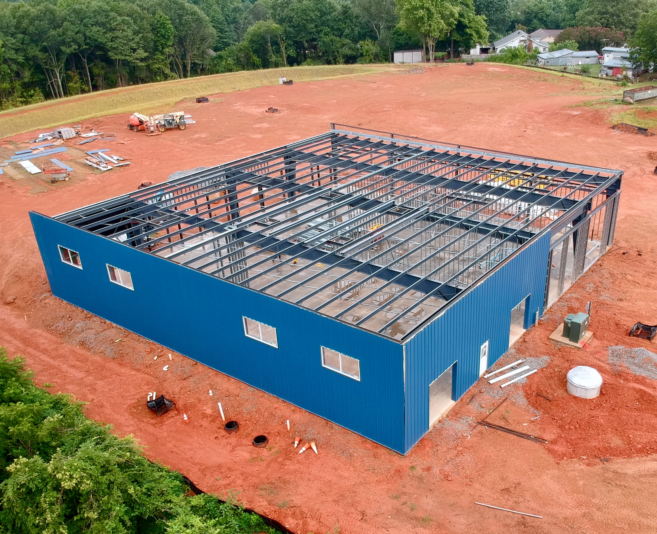 8/1/19  The Southern Growl Beer Company is deep in construction at it's new site, 155 N Buncombe. The building is up and will soon have all of its siding and walls.. if you have ever built a house, you know exactly how exciting it is! The brewing equipment is in production and will be delivered soon. It will still be a few weeks before we have an opening date, because construction and permitting is unpredictable until it's done. We are expecting to move out of our current space and open the doors to the new Brewery sometime in October.   For now, there's lots to do. Sure it can be stressful to look at that long to-do list, but this is what we live for. We love building things and making a space into an awesome place where people can come together and feel at home. This week, Matt's been in the workshop every day making tables & benches, and preparing wood for the reclaimed wood wall. Anna stayed up late preparing for the new and improved beer style flow chart for the brewery. Jason has been brewing beer and tweaking the recipes to nail down the IPA, Marzen, Irish Red, Witbier, and Stout. And Joey was testing menu items for ultimate deliciousness on opening night.   If you are itching to get involved with the new brewery, mark your calendar for the launch of our Indiegogo campaign.  We will be launching the crowdfunding campaign..  Monday AUGUST 5 at noon.   We had a lot of fun coming up with unique perks that you will love.. like a little TSG recipe book, Sponsor a Bar Stool, House Pickles, Burger collaboration dedication, and more. No need to restrain yourself, just get one of each.