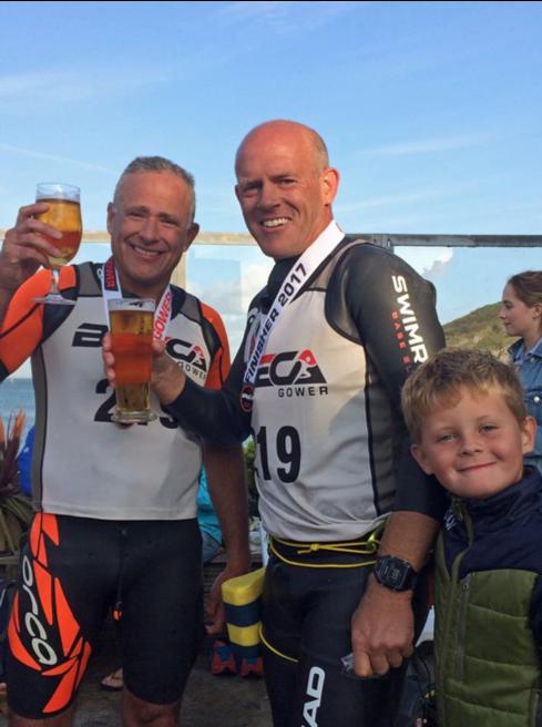 Breca Gower swimrun finish line beer