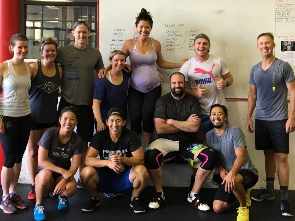 "Anne and Jason dropping in at their old stomping grounds, CrossFit Westside in Vancouver, while Anne was 7 months pregnant. Work out of the day was named ""Prego WOD"""