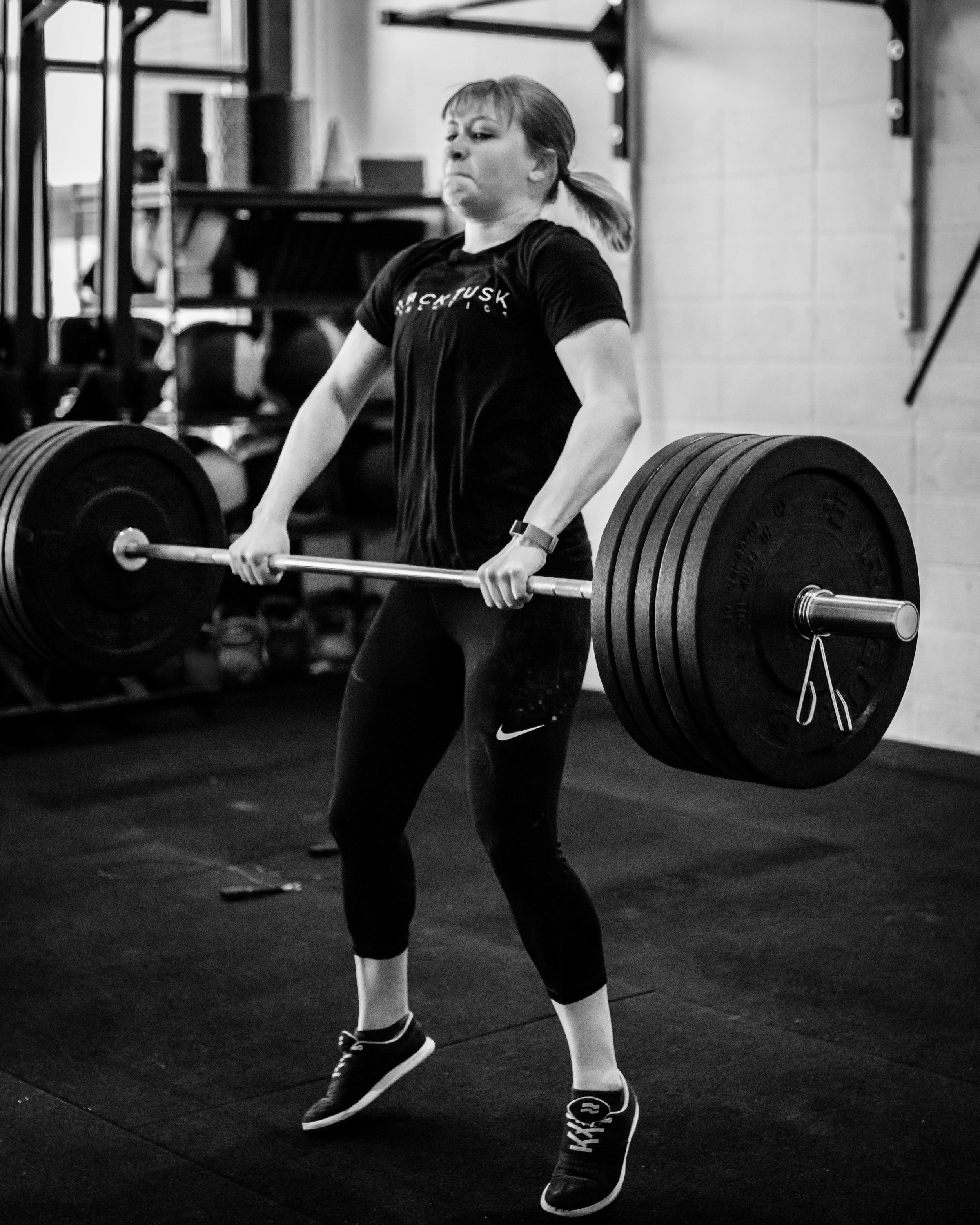 One of our athletes, Lauren. She currently wears multiple hats, including new graduate, server and volunteer. Lauren recently ran her longest distance ever of 14.7km, PR'd her clean at 135# and achieved her goal of unassisted pull ups!