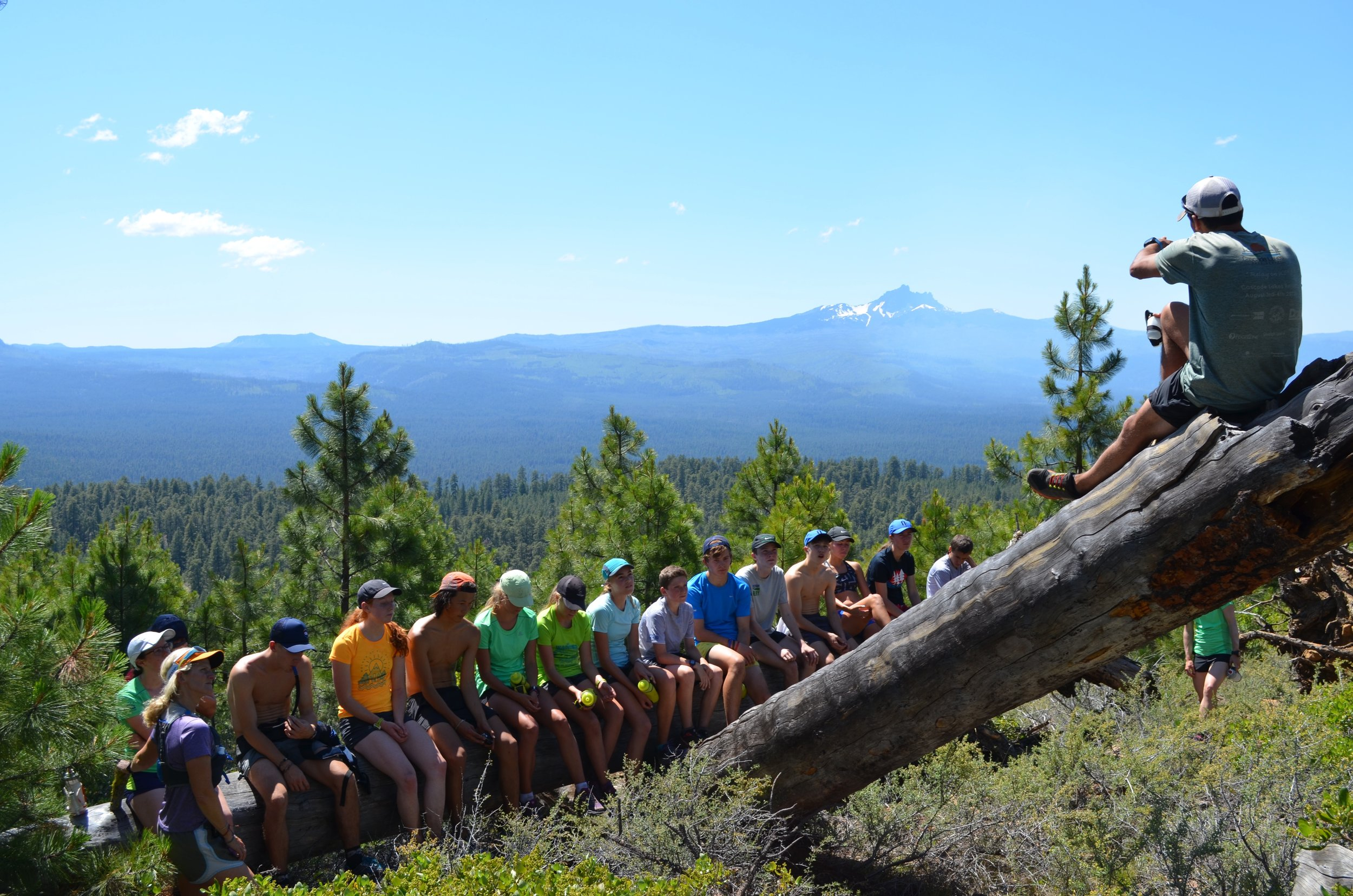 Couldn't ask for a better classroom. Youth getting a geology lesson inside an ancient shield volcano from Forest Service Biologist Monty.