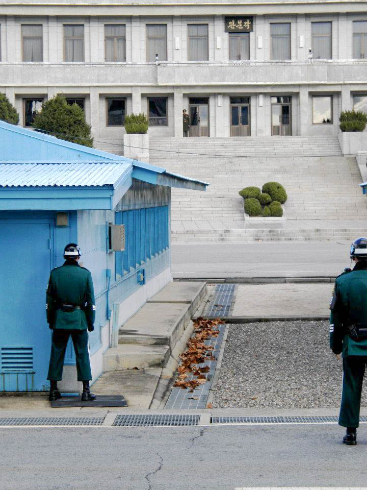 """The line of demarcation is that cement line you see on the ground in the middle. We were told we were being video taped by NK. The SK soldiers were not allowed to move from this """"neutral"""" stance for their entire shift."""
