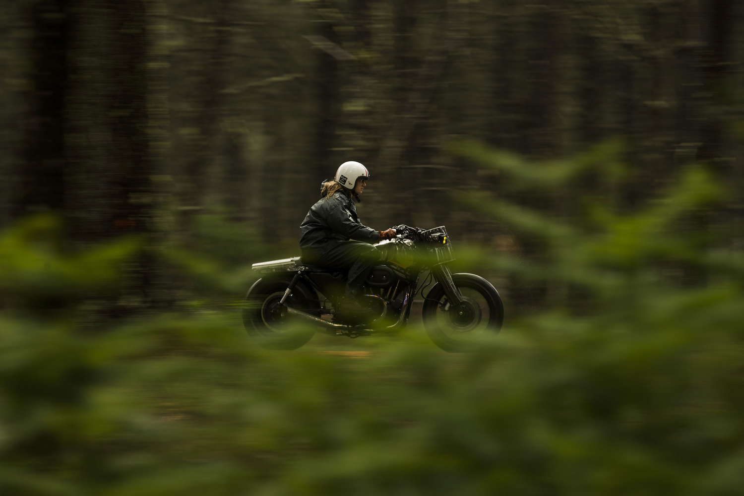 El Solitario's co-founder  Valeria Líbano  drives the  Malo/Bueno  through  Santa María de Oia forest  on May 1, 2015, in Galician  Rias Baixas , Spain. Ex commodity trader  David Borrás and his wife fashion designer Valeria Líbano founded El Solitario Motorcycles as a personal bet to offer their own style of conceiving motorcycles and the fashion market related with them. Malo/Bueno is the customization of a 1200cc  Harley Davidson Sportster  made with  nickel-plated steel . Cast sculptors, a community trader and a musician have something in common: they have made the passion of customizing motorbikes their own business. Valtoron Sculptured Motorcycles, Café Racer Obsession and El Solitario Motorcycles are the dreams-come-true of the Delgado Brothers, Federico Ruiz and David Borrás.