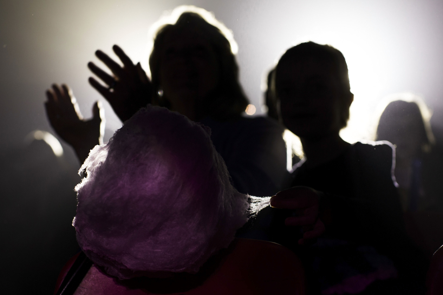 A  kid  takes a chunk of  marshmallow  as the  audience  clap during a  show  taking place at  Gran Circo Mundial circus  on November 29, 2015 in Madrid, Spain.  Gran Circo Mundial  is a 40 years-old Spanish  circus  where  famil y lifes and stories have mixed together across the time. From the  trapeze  artists of the  Pyongyang National Circus  to the  Rampin  family descendants,  clown s,  magician s or aerial  permormer s share the  stage  and part of their private lifes. Their show was running inMadrid in Autumn 2015.