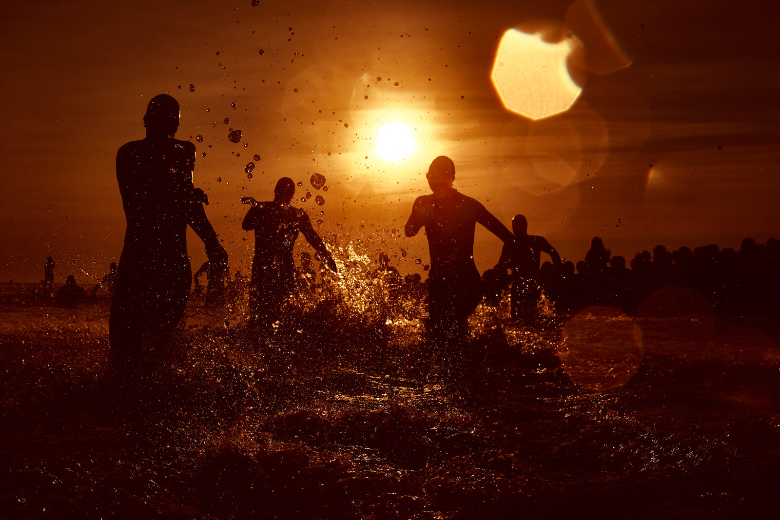 Athletes enter to the water during the rolling start of the Ironman Emilia Romagna swimming course on September 22, 2018 in Cervia, Italy.