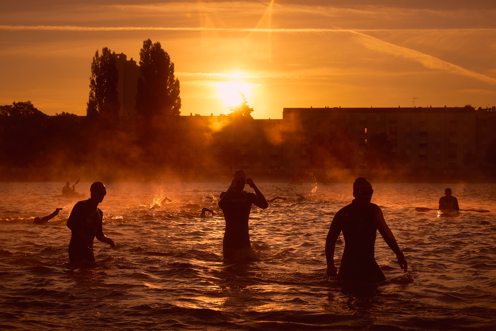 Athletes compete during the swimming course of Ironman vichy on August 25, 2018 in Vichy, France.