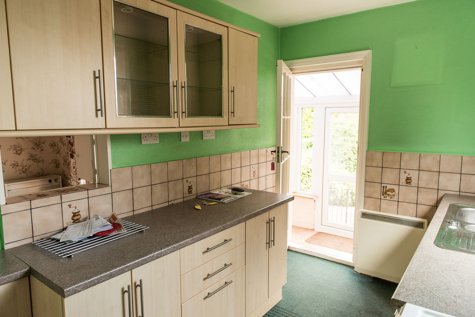 NEWISH KITCHEN WITH ANCIENT TILES & A POP OF APPLE GREEN. FAB COMBO.