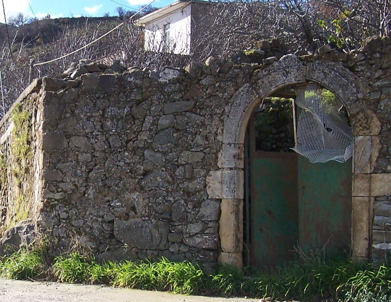 The name - Arch Clinic - Our clinic name came from the arch in this photo.It's what was left of my grandfather's home in Crete when I visited for the first time. This place planted the seeds of my love for natural medicine.
