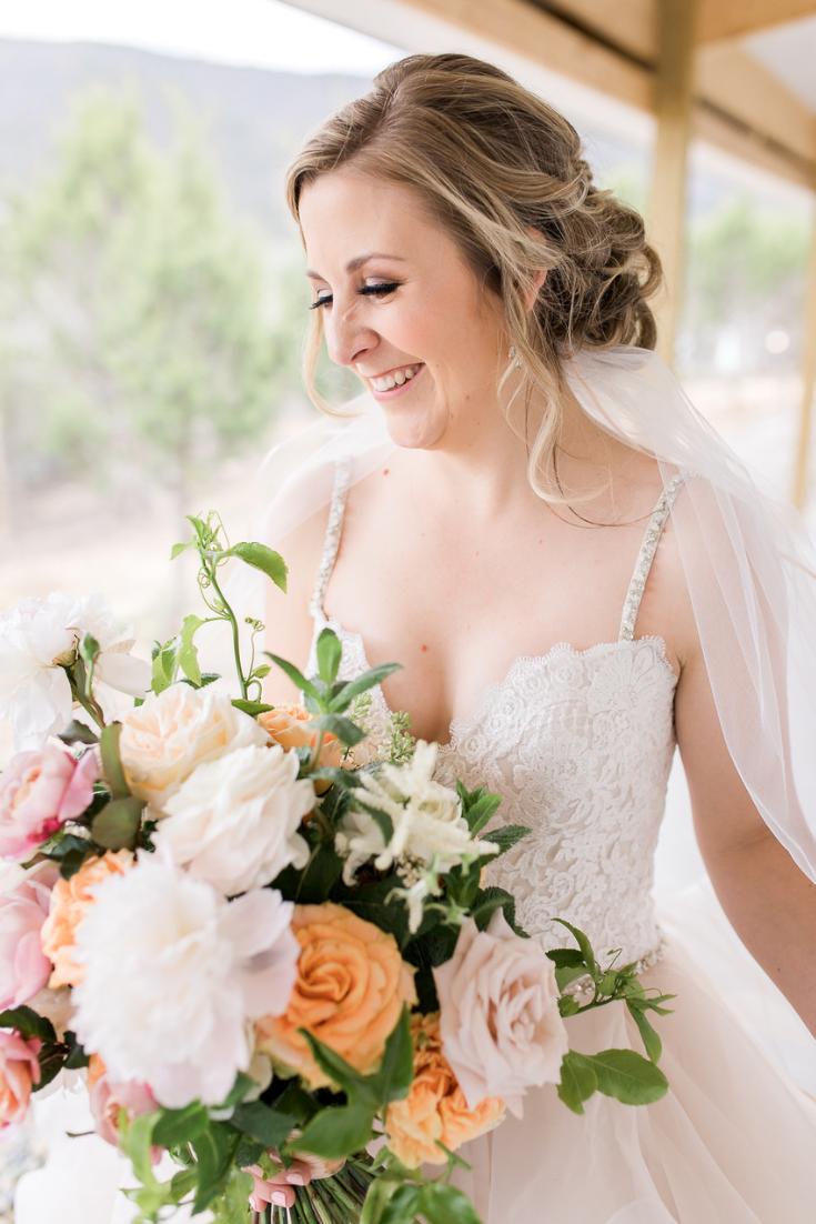 Photography:  Megan Lee Photography  Florals:  Poppy's Flower Shop