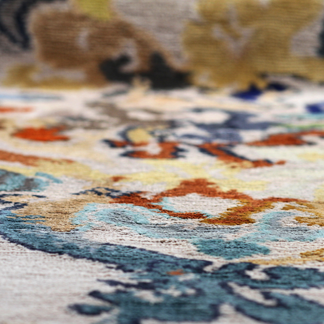 A dreamy and enchanting design, the Versailles area rug is a wonderful addition to your décor. Use anywhere in your home for an heirloom area rug that is durable as it is beautiful.   This hand-knotted 100% Tibetan silk rug features a design woven directly from an original Joe Ginsberg watercolor.