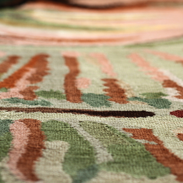 Earthy hues and vibrant patterns intermingle to create this animated design. The Jungle Boogie area rug becomes a dynamic centerpiece in any room.   This hand-knotted 100% Tibetan silk rug features a design woven directly from an original Joe Ginsberg watercolor.